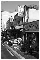 Shopkeepers and storefronts. Daegu, South Korea (black and white)