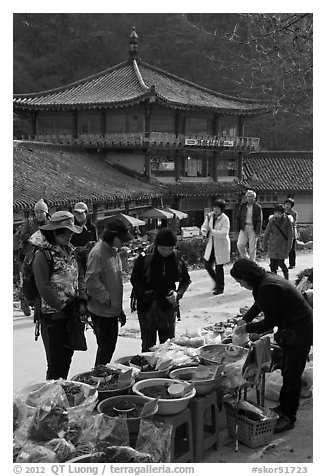 Hikers buy natural products near Haeinsa. South Korea (black and white)