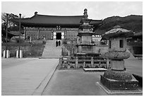Three-story stone pagoda and main hall, Haeinsa Temple. South Korea ( black and white)