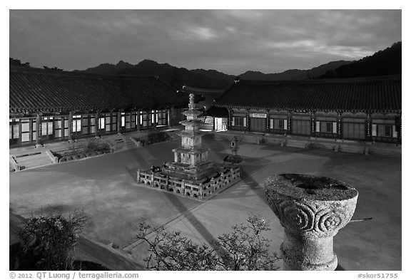 Stone pagoda and courtyard at dusk, Haeinsa Temple. South Korea (black and white)