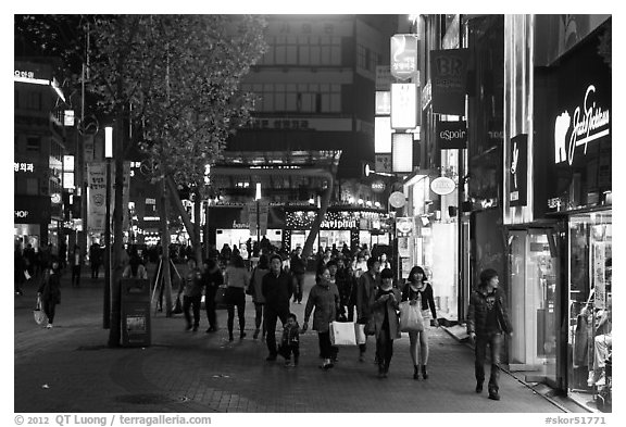 Shoppers strolling on pedestrian street at night. Daegu, South Korea (black and white)