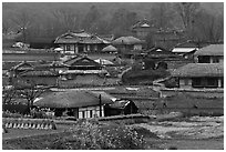 Straw roofed houses and tile roofed houses. Hahoe Folk Village, South Korea (black and white)