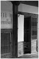 Wooden interior doors in residence. Hahoe Folk Village, South Korea ( black and white)
