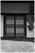 Nuts, screen door, and baskets. Hahoe Folk Village, South Korea (black and white)