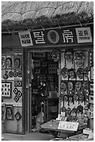 Store selling traditional Hahoe masks. Hahoe Folk Village, South Korea ( black and white)