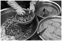 Hands mixing kim chee. Gyeongju, South Korea (black and white)