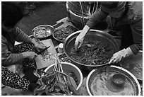 Women making gimchi. Gyeongju, South Korea (black and white)