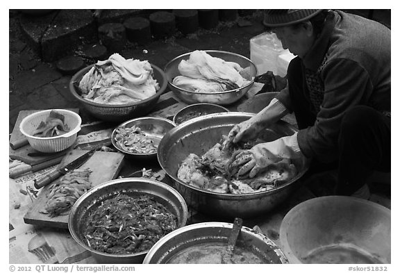Woman mxing gimchi. Gyeongju, South Korea (black and white)