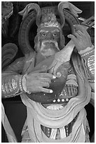 Wooden statue with musical instrument, Bulguk-sa. Gyeongju, South Korea ( black and white)