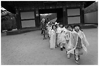 Schoolchildren with raingear, Bulguksa. Gyeongju, South Korea (black and white)