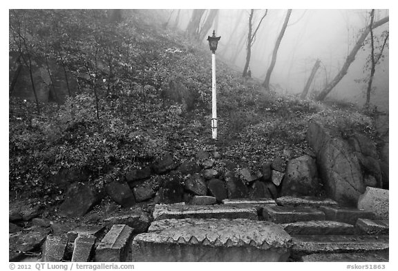 Stones and lantern in fog, Seokguram. Gyeongju, South Korea (black and white)