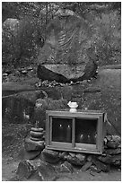 Shrine and carved rock, Namsan Mountain. Gyeongju, South Korea ( black and white)