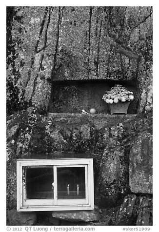 Shrine with candles and flowers, Mt Namsan. Gyeongju, South Korea (black and white)