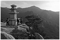 Women circling stone pagoda, Mt Namsan. Gyeongju, South Korea ( black and white)