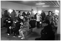 Hikers eating noodles inside Witseoreum shelter, Hallasan. Jeju Island, South Korea (black and white)