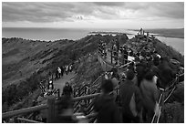 Visitors on top of Seongsang Ilchulbong. Jeju Island, South Korea (black and white)