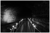 Metal walkway in Manjanggul cave. Jeju Island, South Korea (black and white)