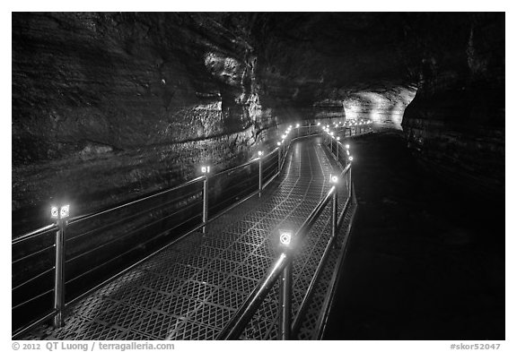 Walkway in Geomunoreum cave with world heritage logos. Jeju Island, South Korea (black and white)