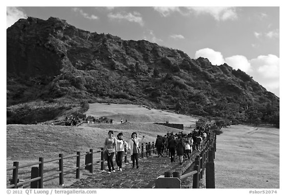 Seongsang Ilchulbong and tourists on path. Jeju Island, South Korea (black and white)