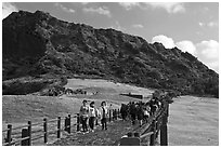 Seongsang Ilchulbong and tourists on path. Jeju Island, South Korea ( black and white)