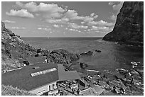Cove and Haeneyo house, Seongsang Ilchulbong. Jeju Island, South Korea (black and white)