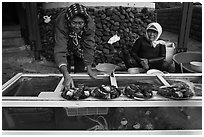 Haeneyo women selling seafood. Jeju Island, South Korea (black and white)