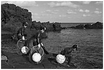 Old Haeneyo women preparing for dive. Jeju Island, South Korea (black and white)