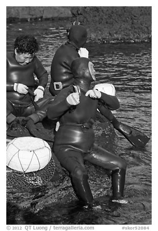 Haeneyo women arranging wetsuits. Jeju Island, South Korea (black and white)