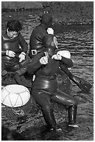 Haeneyo women arranging wetsuits. Jeju Island, South Korea ( black and white)