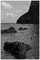 Cove with Haeneyo woman diving. Jeju Island, South Korea (black and white)