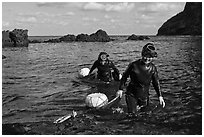 Haeneyo women walking out of water. Jeju Island, South Korea ( black and white)