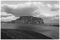 Beach and Tuff Cone,  Ilchulbong. Jeju Island, South Korea (black and white)