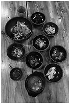 Meal with assorted kim-chi. Jeju Island, South Korea ( black and white)
