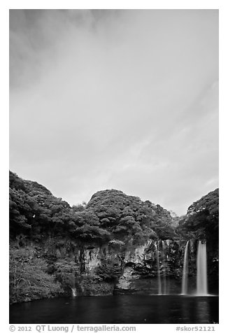 Cheongjiyeon Pokpo falls and clouds, sunrise, Seogwipo. Jeju Island, South Korea (black and white)