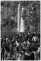 Crowd at the base of waterfall, Jeongbang Pokpo, Seogwipo. Jeju Island, South Korea (black and white)