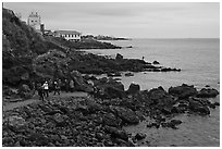 Tourists at Yongduam Rock, Jeju-si. Jeju Island, South Korea ( black and white)