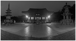 Frontal view of main hall and two pagodas at night, Bulguksa. Gyeongju, South Korea (black and white)