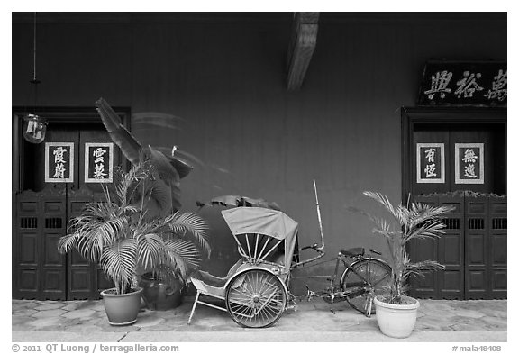 Trishaw and doors, Cheong Fatt Tze Mansion. George Town, Penang, Malaysia (black and white)