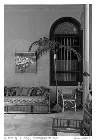 Chairs and blue wall, Cheong Fatt Tze Mansion. George Town, Penang, Malaysia