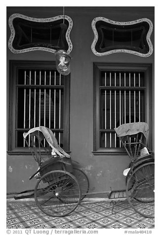 Rickshaws and windows, Cheong Fatt Tze Mansion. George Town, Penang, Malaysia (black and white)