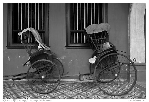 Bicycle rickshaws, Cheong Fatt Tze Mansion. George Town, Penang, Malaysia (black and white)