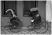 Bicycle rickshaws, Cheong Fatt Tze Mansion. George Town, Penang, Malaysia ( black and white)