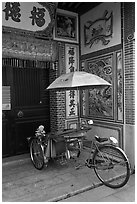Bicycle rickshaw at temple entrance. George Town, Penang, Malaysia ( black and white)
