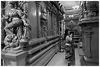 Woman worshipping at Sri Mariamman Temple. George Town, Penang, Malaysia (black and white)