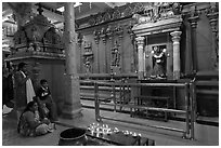 Family in prayer, Sri Mariamman Temple. George Town, Penang, Malaysia (black and white)