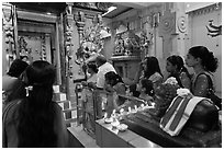 Devotees inside Tamil Nadu temple. George Town, Penang, Malaysia ( black and white)