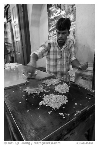Man preparing indian food. George Town, Penang, Malaysia (black and white)