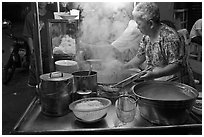 Noddles prepared on foodstall by night. George Town, Penang, Malaysia (black and white)