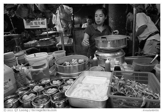 Woman serving dumplings. George Town, Penang, Malaysia (black and white)