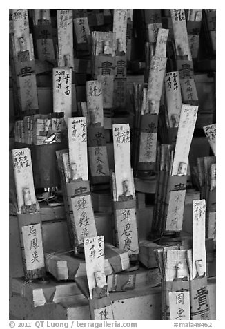 Sticks with names in Chinese characters, Kuan Yin Teng temple. George Town, Penang, Malaysia (black and white)